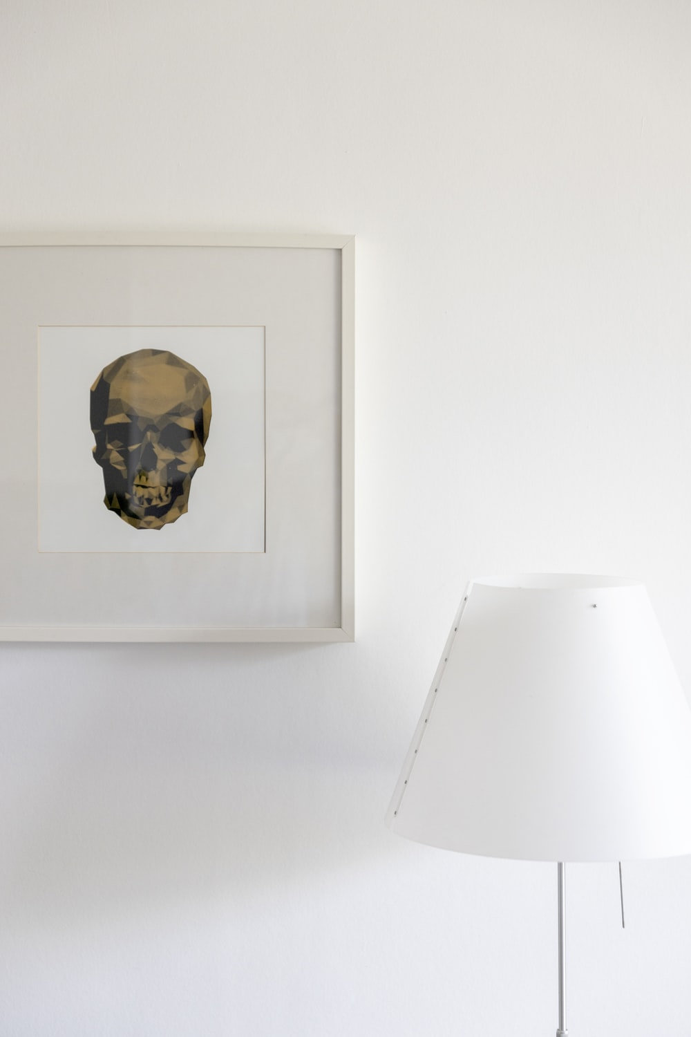 mans face sketch on white wall