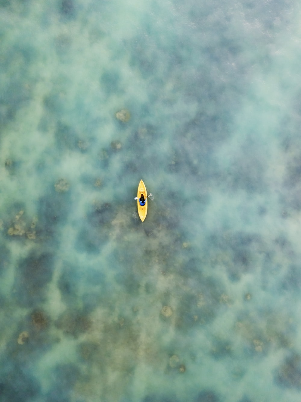 yellow and black boat on water