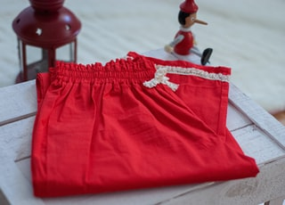 red shorts on white textile