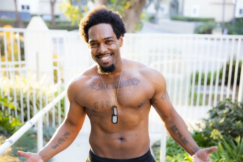 topless man wearing black bottoms