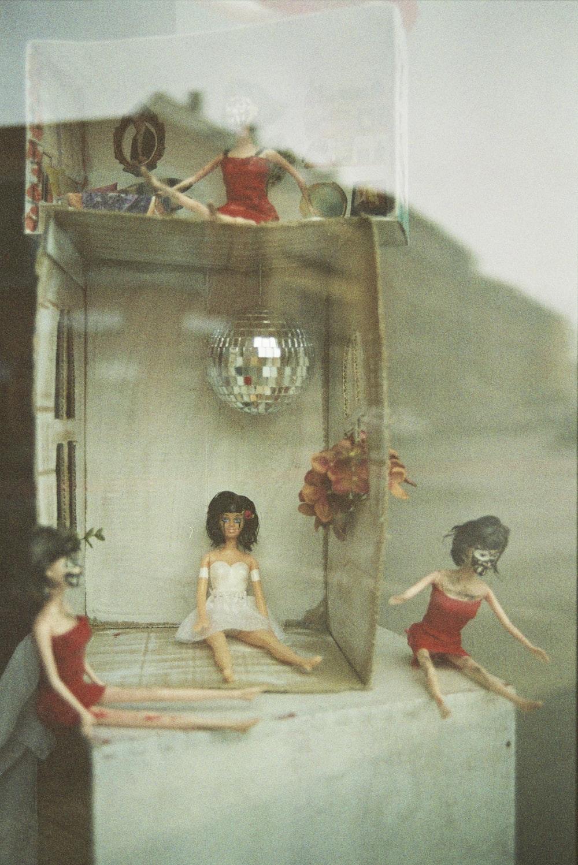 girl in red dress standing beside girl in white dress