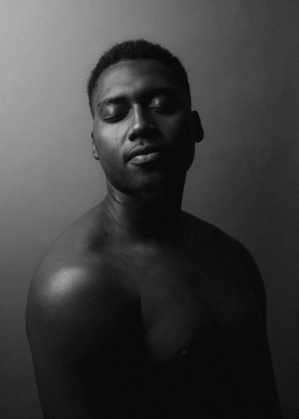 topless man in grayscale photography