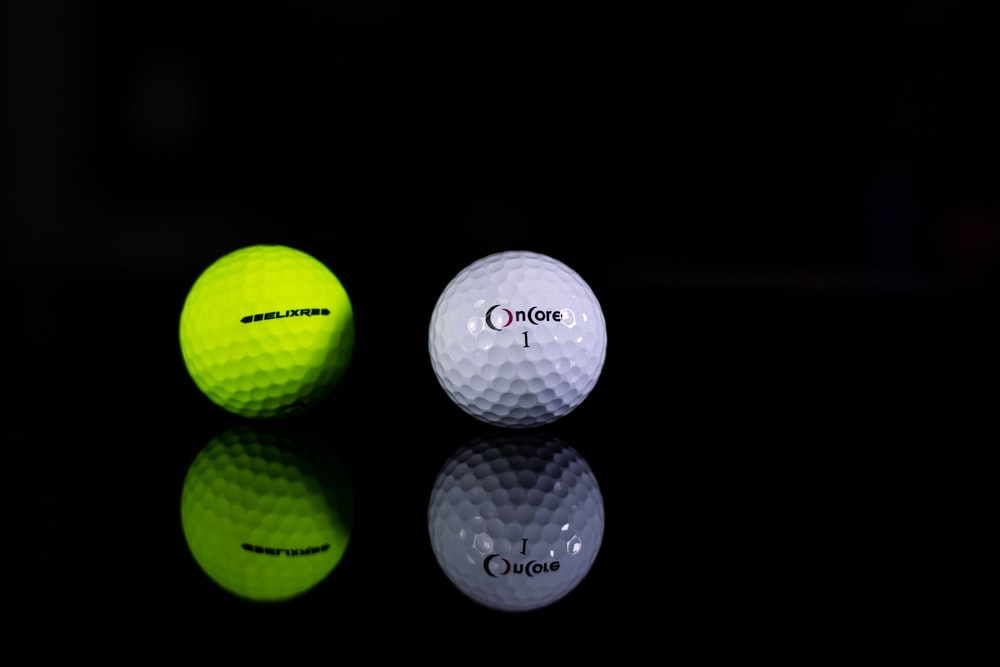 white golf ball in close up photography