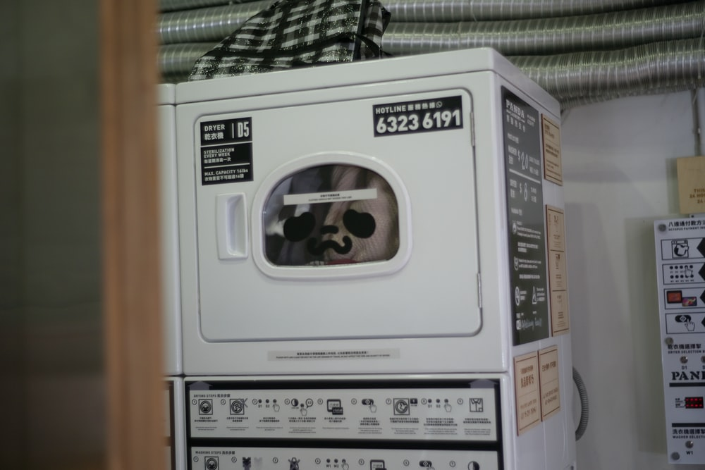white and gray panasonic microwave oven