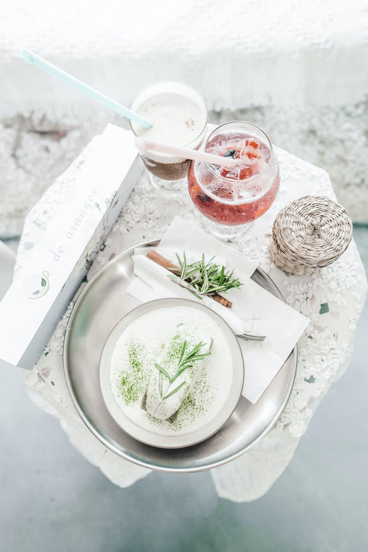 white ceramic round plate on white table cloth