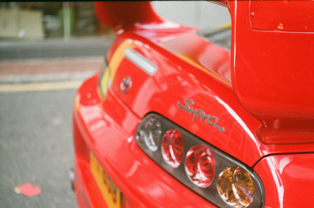 red ferrari car with silver and gold round coins