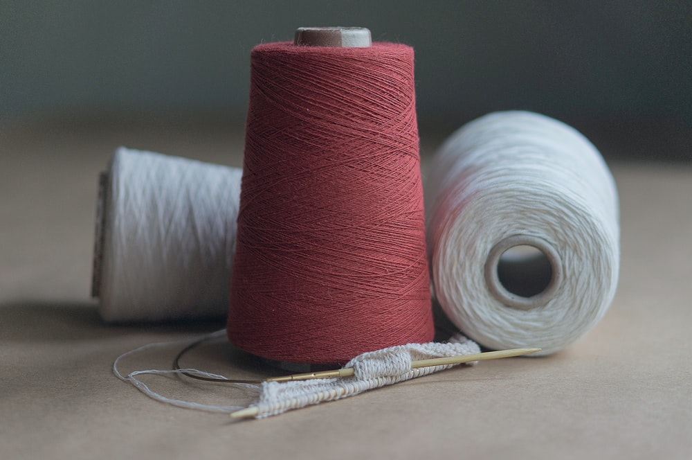 red thread on white paper