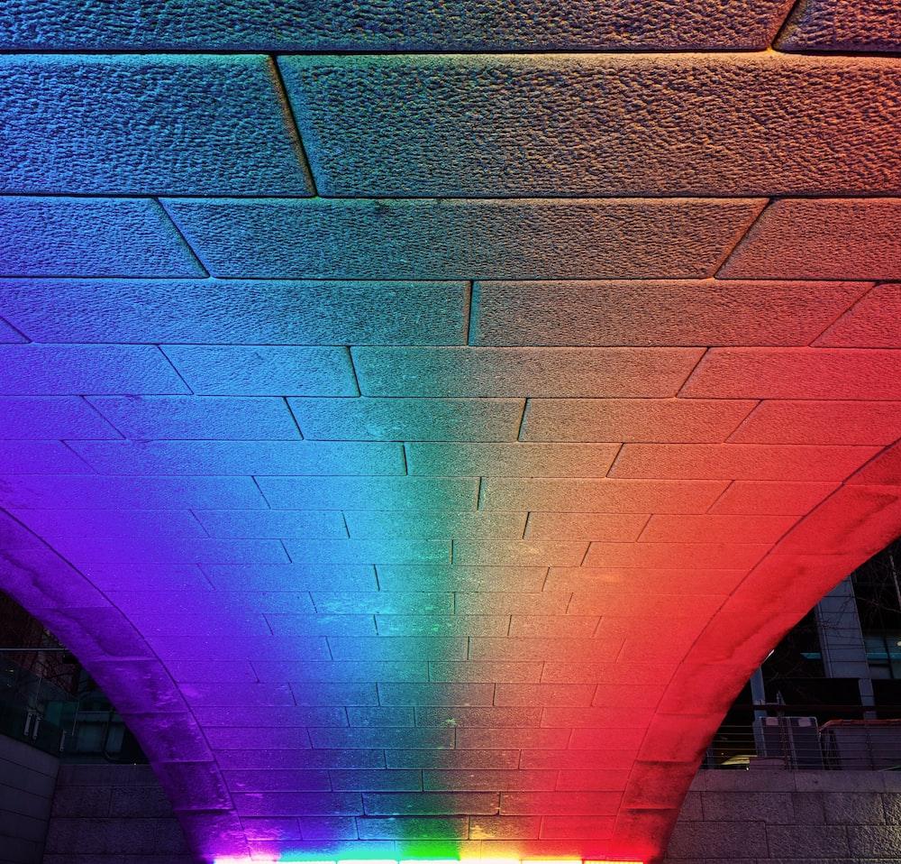 purple light on brown brick wall