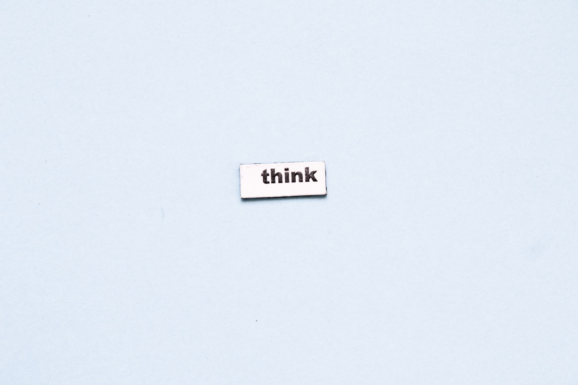 the word think on the pale blue background