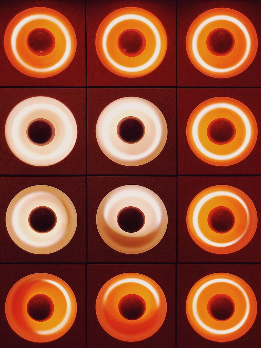 orange and white round wall decor