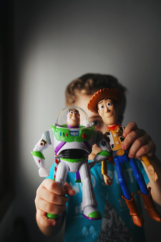 person holding lego mini figure