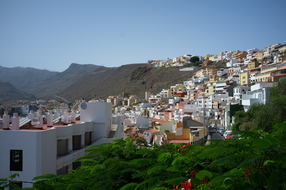 city buildings on mountain during daytime