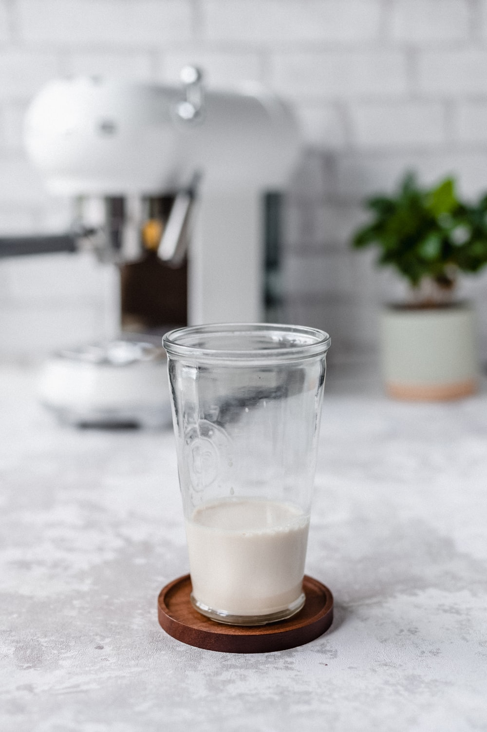 clear drinking glass with white liquid