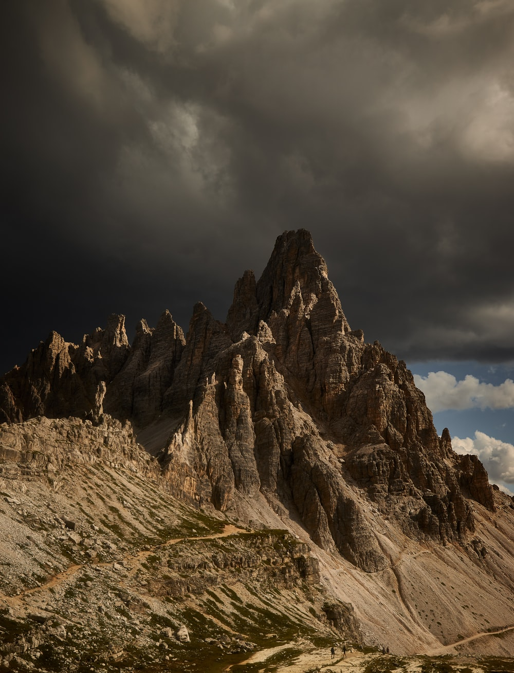 brown rocky mountain under cloudy sky during daytime