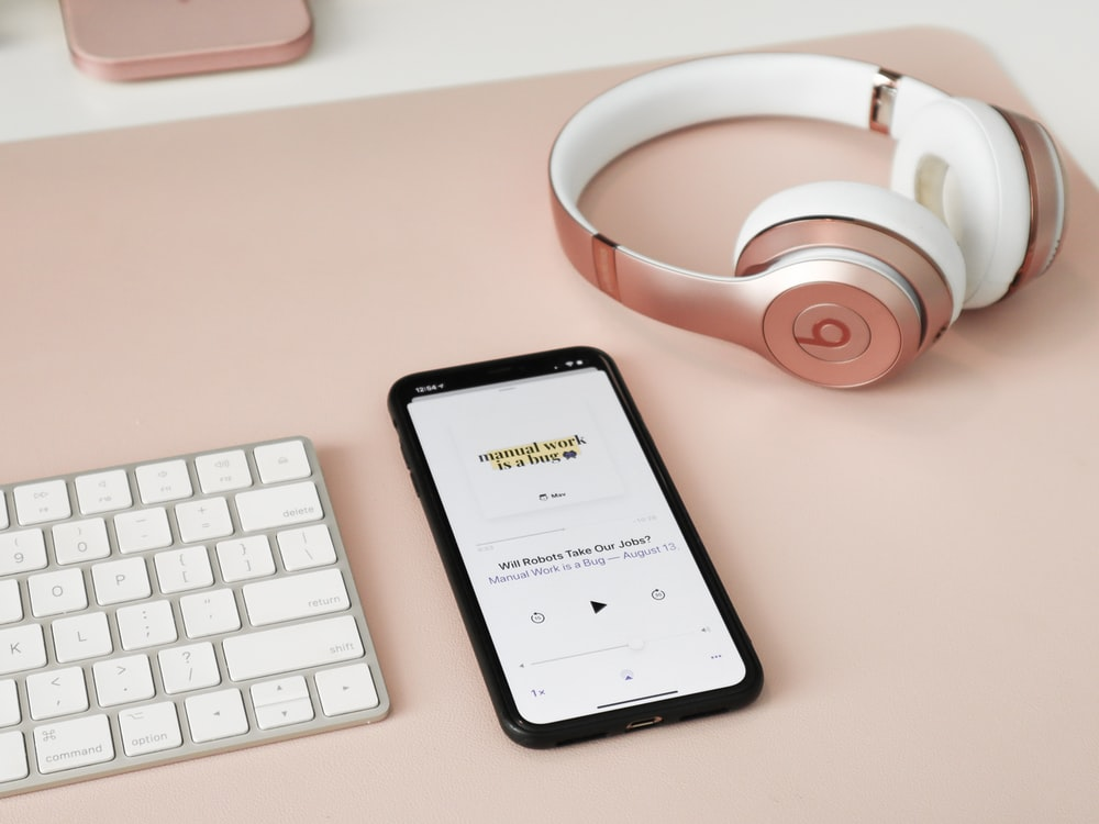 Black Iphone 5 Beside White And Red Beats By Dr Dre Headphones Photo Free Cell Phone Image On Unsplash