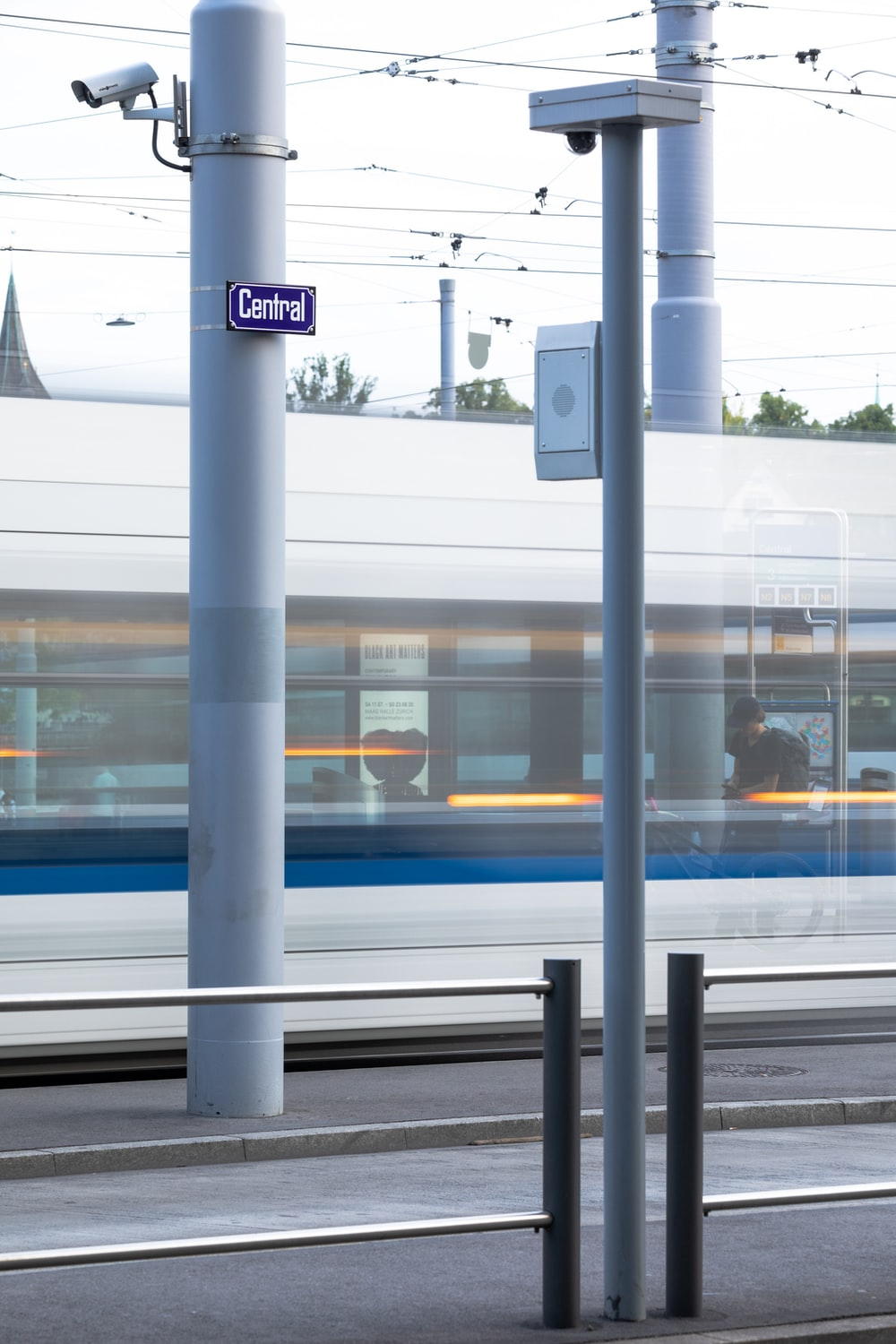 white and blue train on train station during daytime