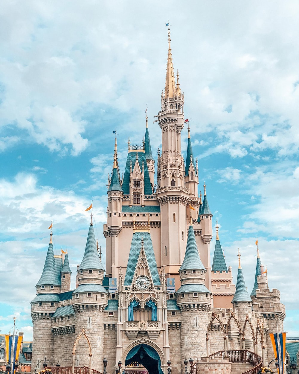 white and blue castle under blue sky and white clouds during daytime