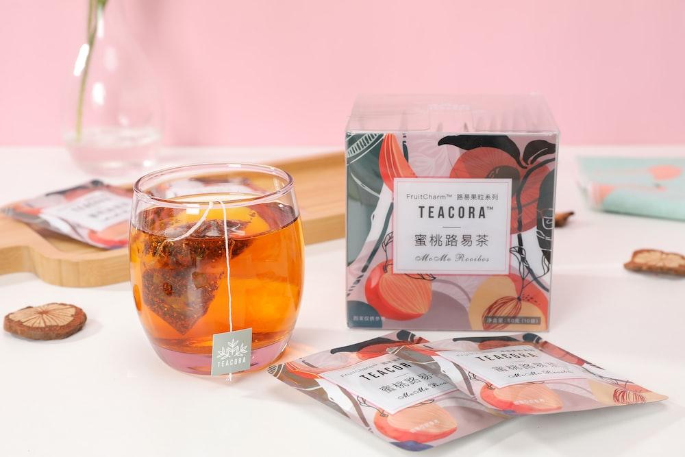 clear glass jar with orange liquid inside
