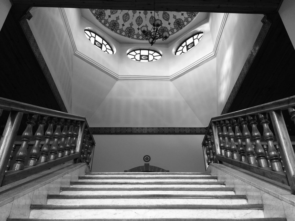 white and black staircase with black railings
