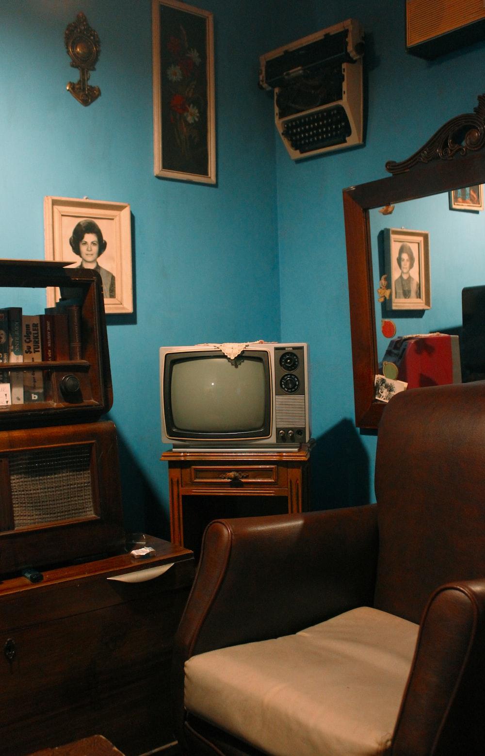 gray crt tv on brown wooden tv rack