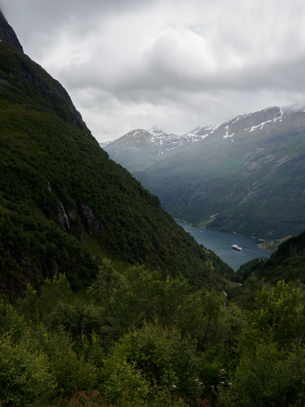 green mountains under white cloudy sky during daytime