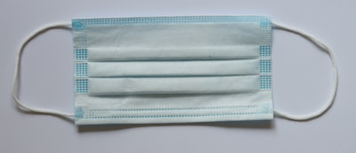white and blue textile on white surface