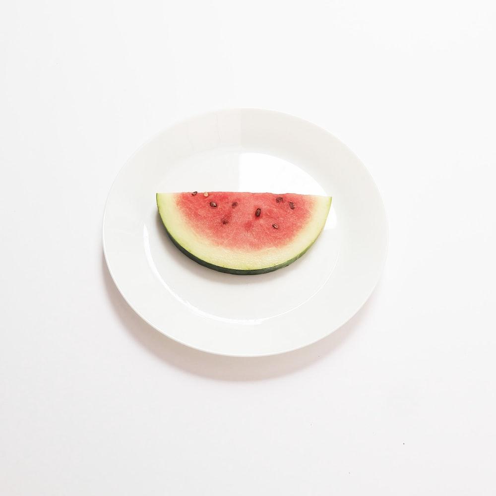 green apple on white ceramic plate