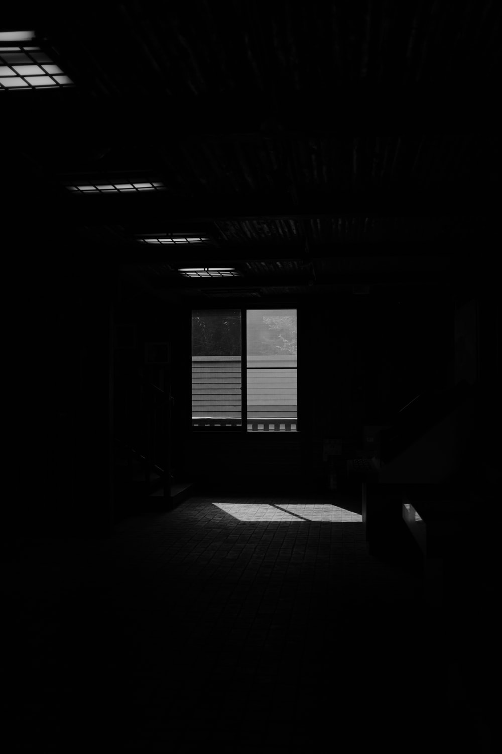 grayscale photo of a room