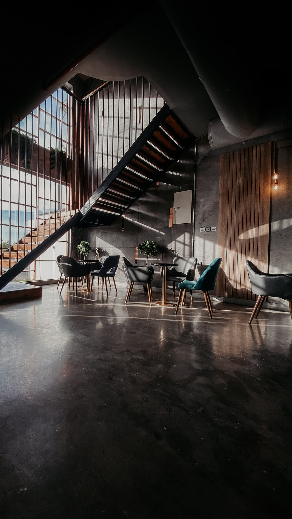 blue and black chairs on brown wooden floor