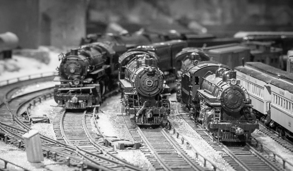 grayscale photo of train on rail track