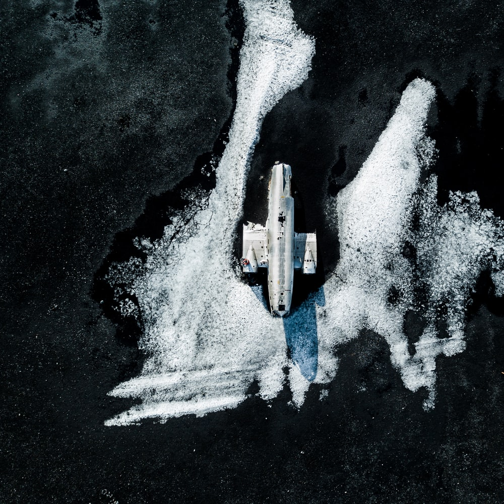 aerial view of white boat on body of water during daytime