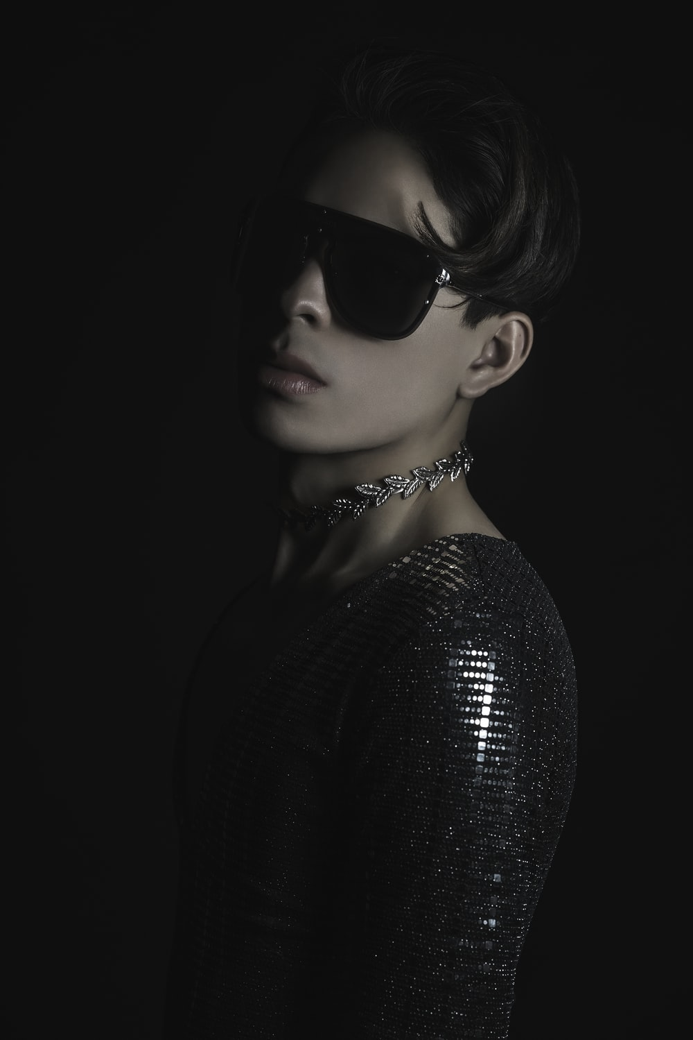 woman in black sunglasses and black shirt