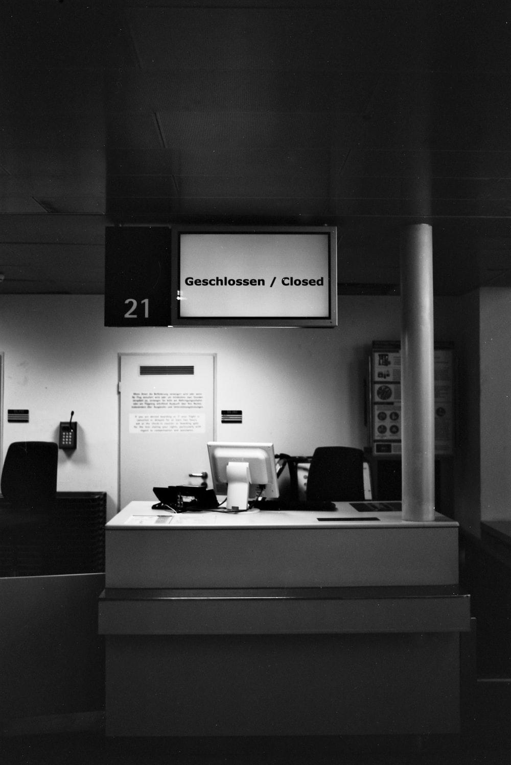 grayscale photo of office room