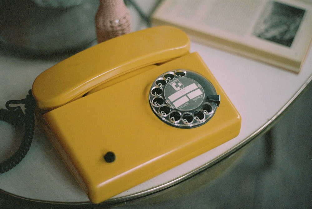 yellow and silver rotary phone