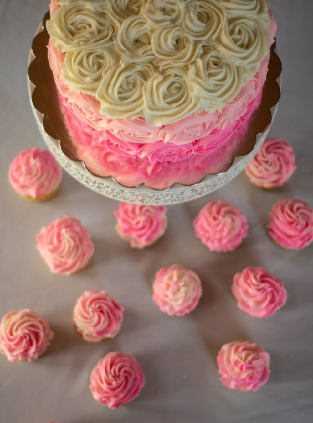 pink and yellow cupcake with pink icing on top
