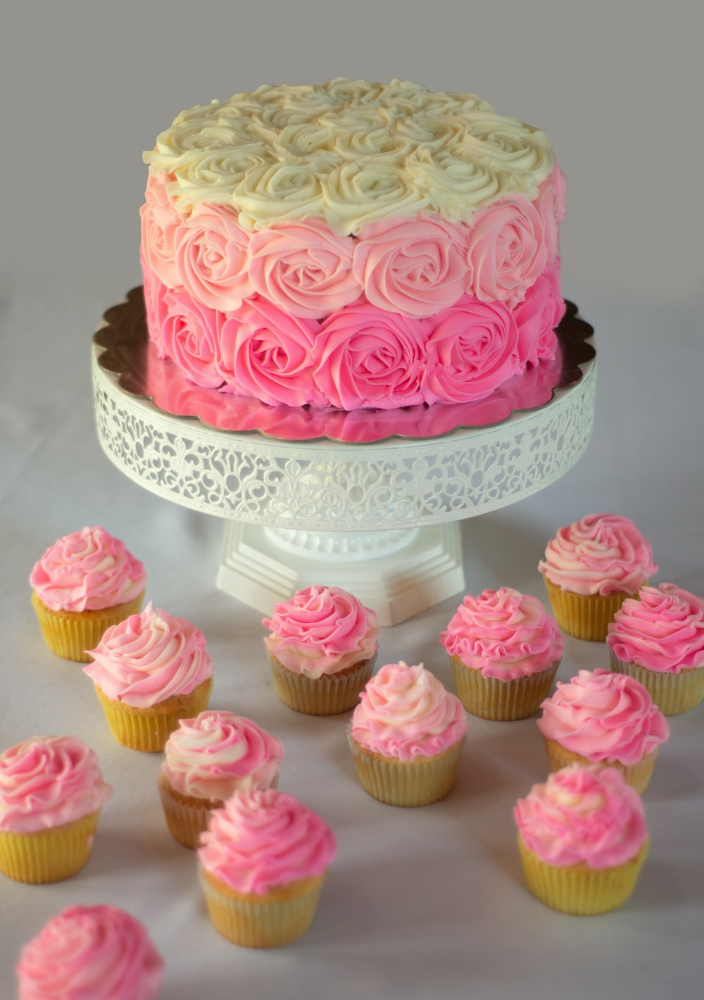 pink and white cake on white table