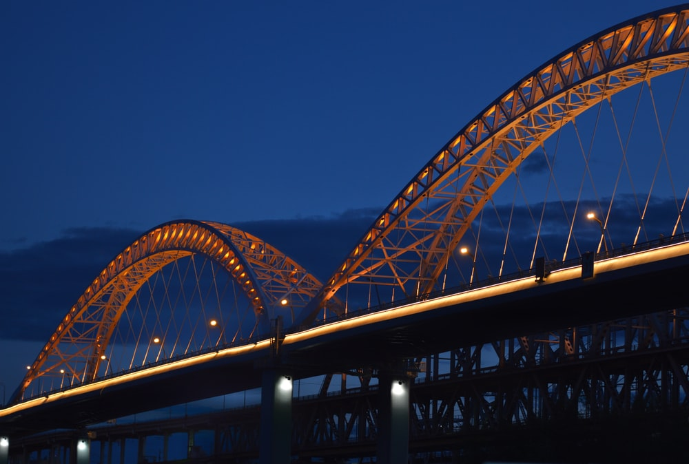 gray metal bridge under blue sky during daytime