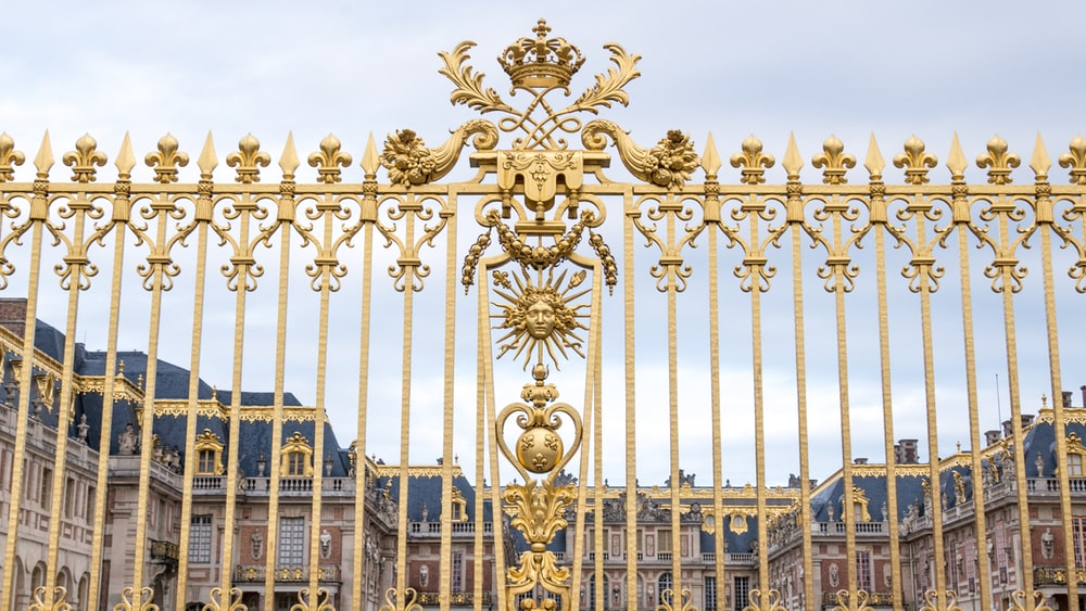 gold and blue metal gate