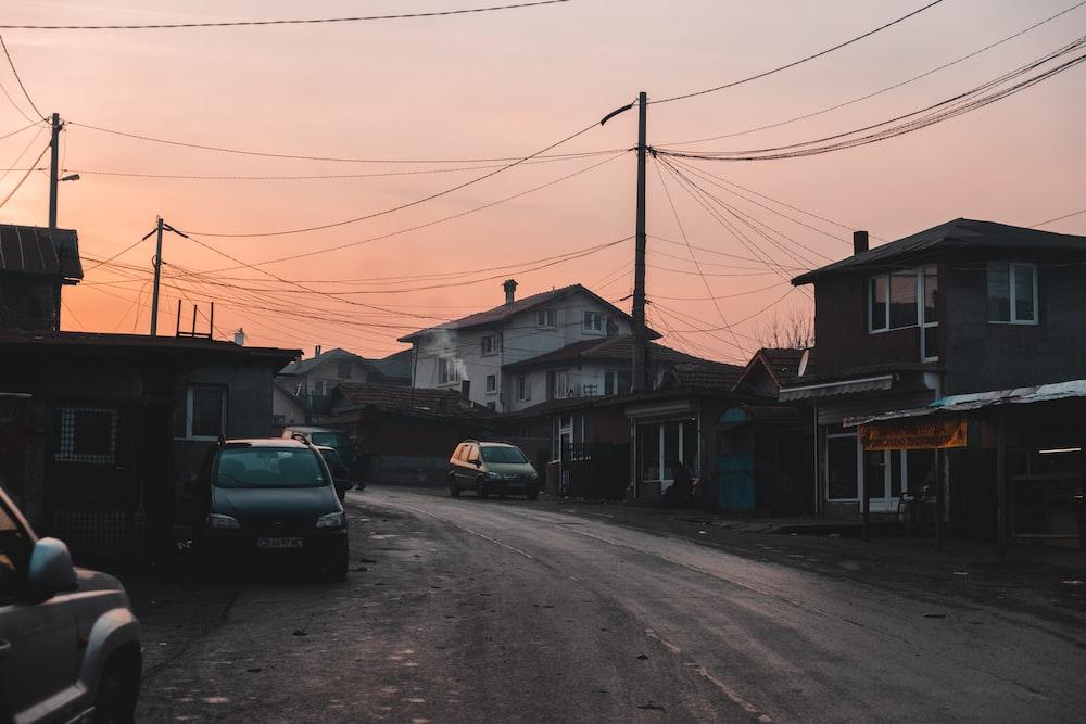 black car parked beside house during daytime
