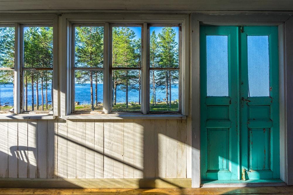 green wooden window frame during daytime