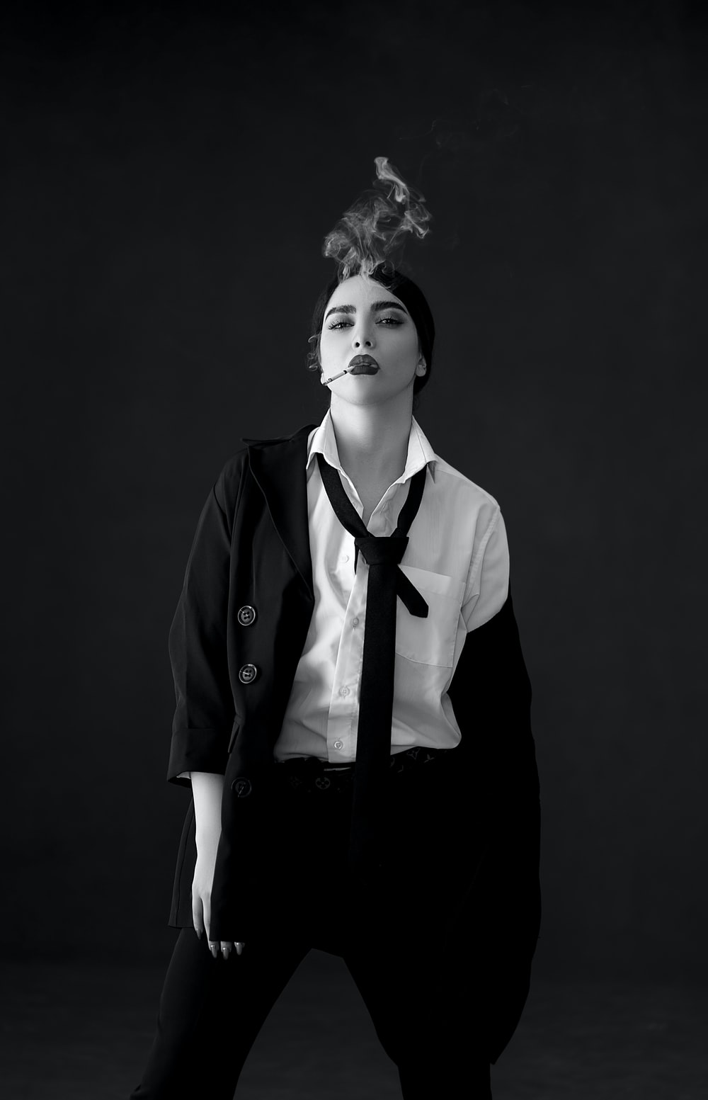 woman in black blazer and white dress shirt