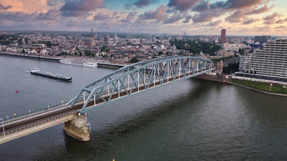 white bridge over river during daytime