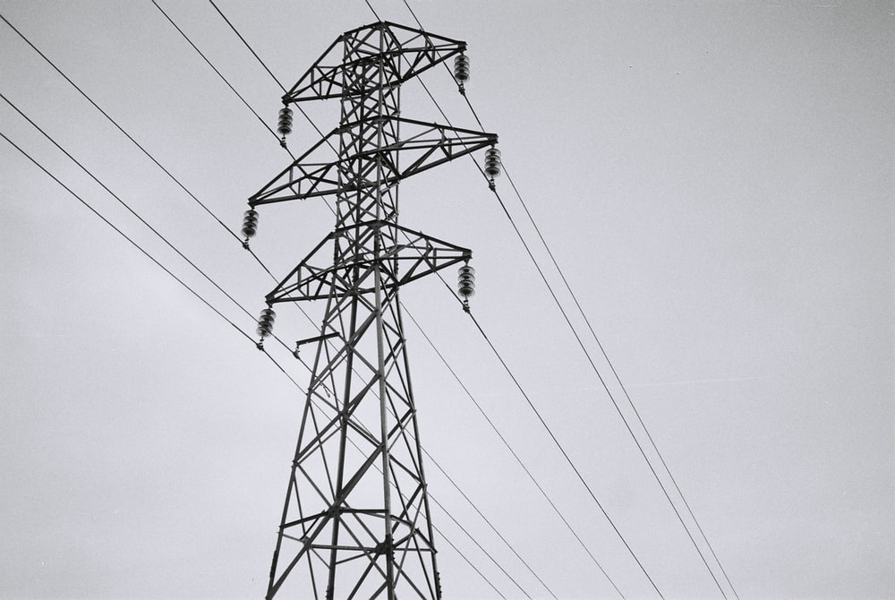 black electric tower under white sky