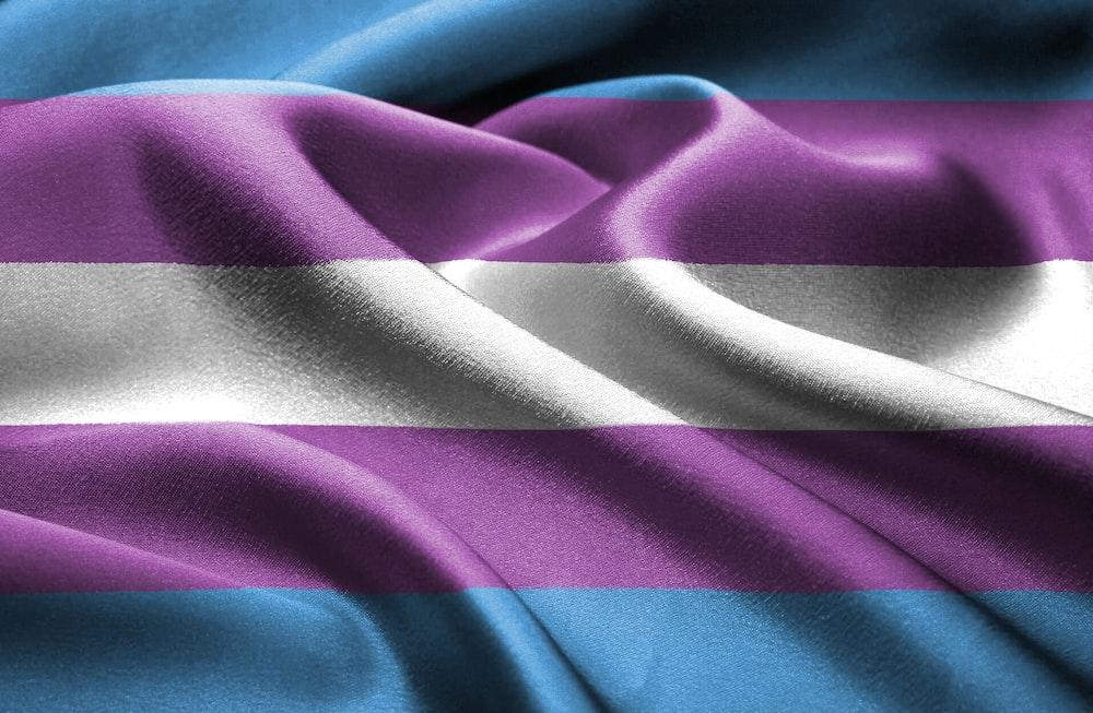 purple and white stripe textile