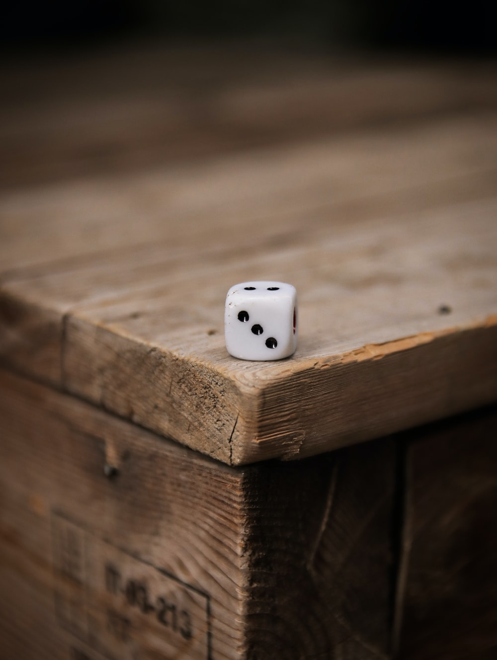 white dice on brown wooden table