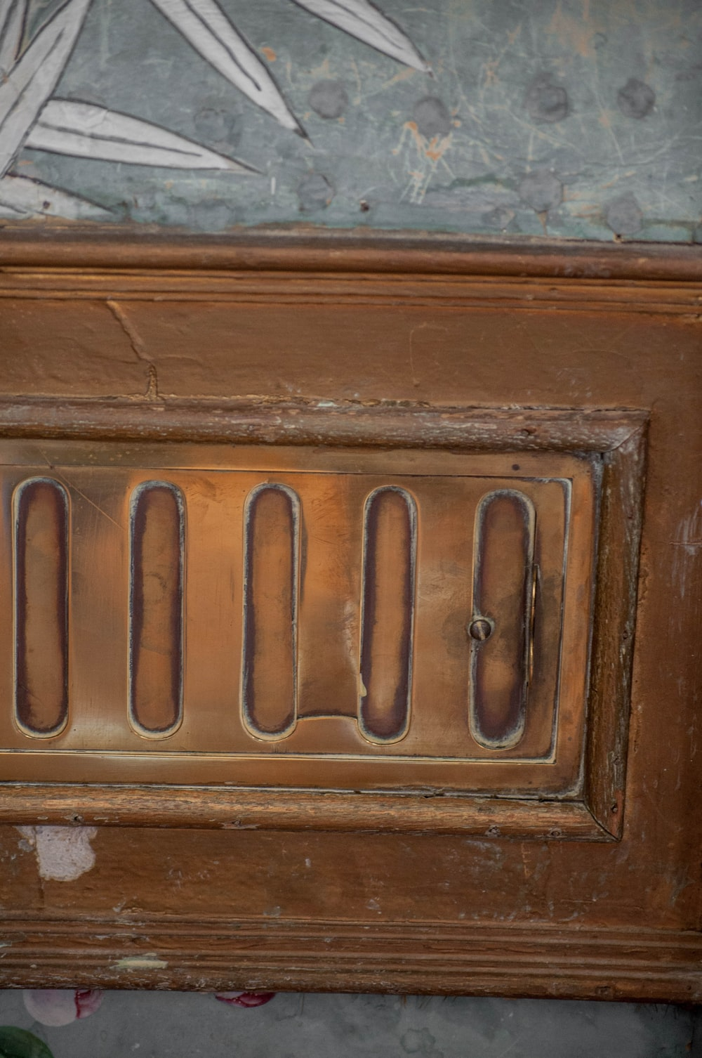 brown wooden door with silver door lever