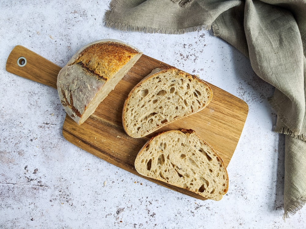 brown bread on brown wooden chopping board