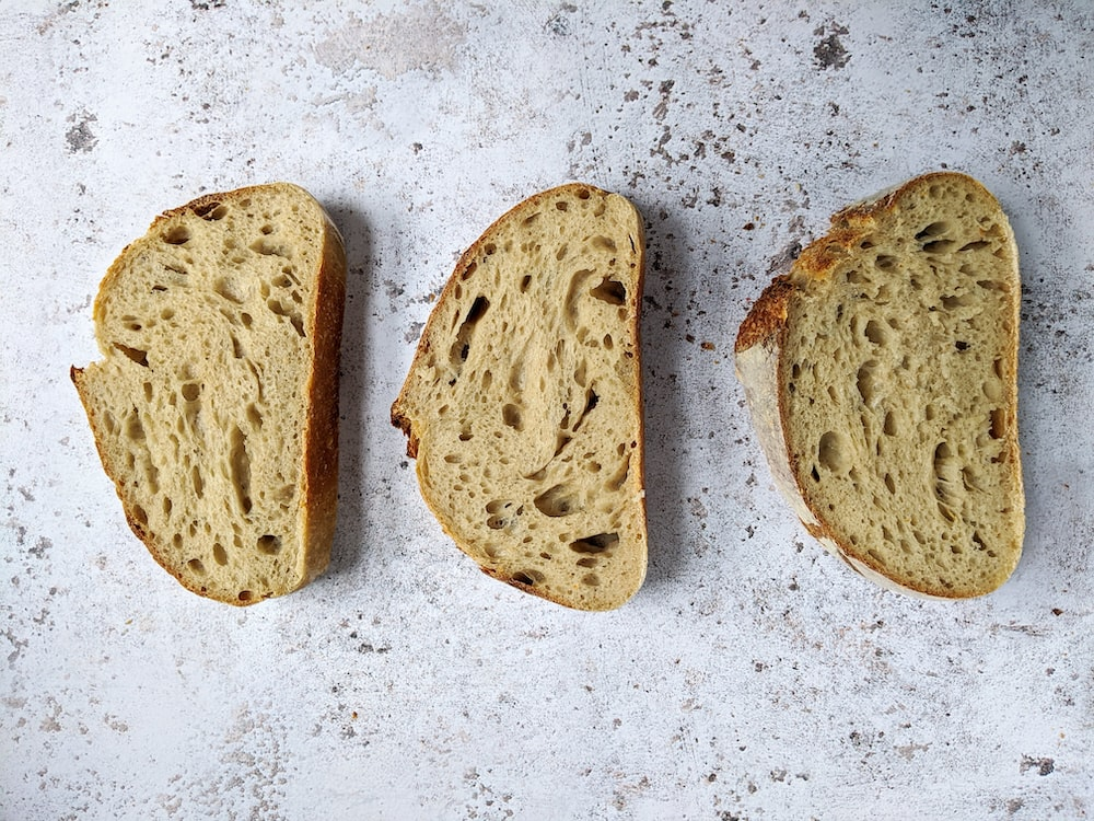 brown bread on white and black surface