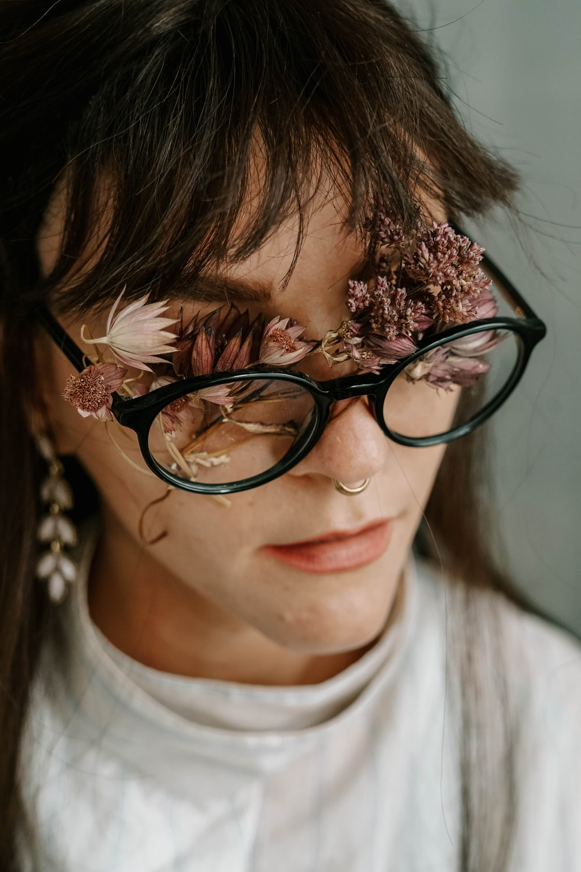 woman in black frame eyeglasses