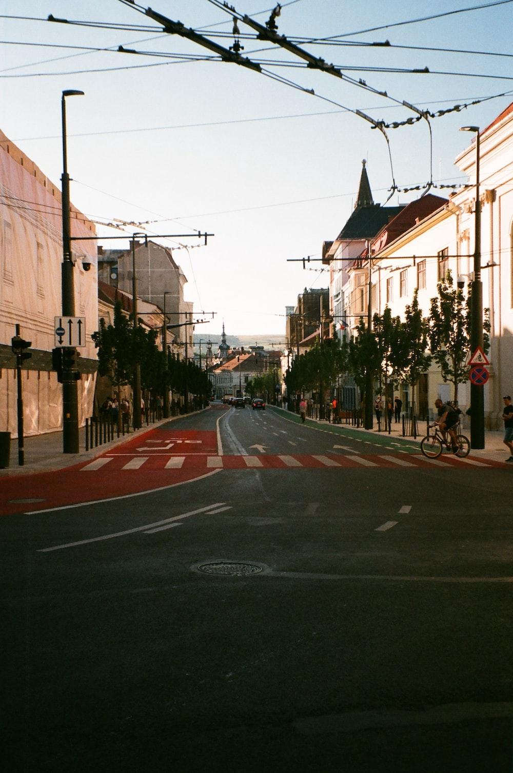 black asphalt road between buildings during daytime